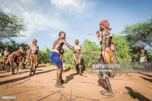 Before the bull jumping ceremony the Maza whip the Hamer women who will defy them and show no fear or signs of pain Hamer tribe