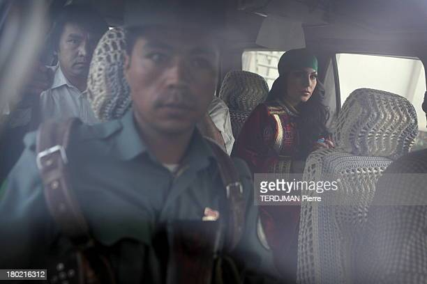 Before the concert Aryana Sayeed arrives with an escort of soldiers armed with Kalashnikovs that ensure her protection Aryana poses with traditional...