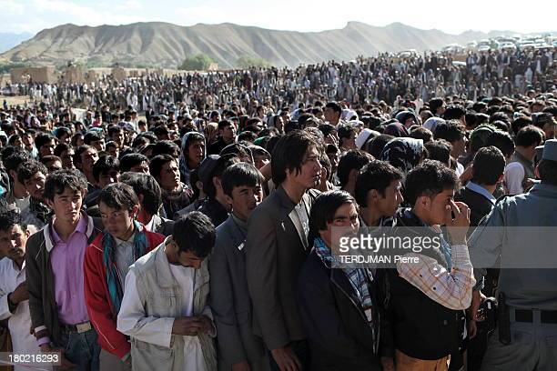 Before the concert men gather in the part dedicated to them on August 15 2013 in BamiyanAfghanistan Afghan singer Aryana Sayeed attends a concert of...