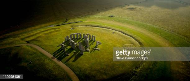 before the crowds arrive - stonehenge stock photos and pictures