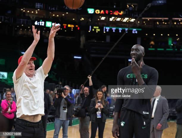 Before the game, tennis great John McEnroe, left, shoots the ball as Celtics center Tacko Fall looked on at right.McEnroe and Celtics forward Gordon...