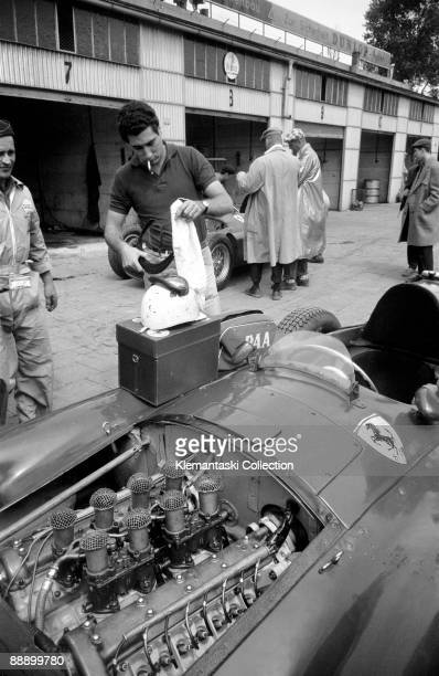 Before The German Grand Prix Nürburgring August 1956 A closeup of Alfonso de Portago unpacking his driving gear on top of his Ferrari/Lancia GP car...