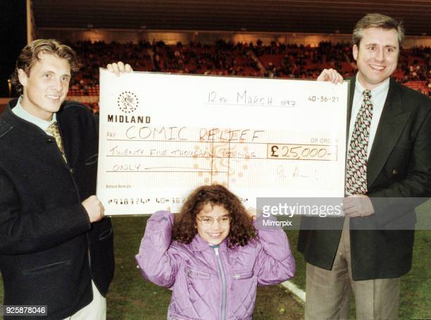 Before the kick off in the CocaCola semifinal between Boro and Stockport Boro star Derek Whyte received a cheque on behalf of Comic Relief from Rufus...