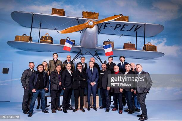 Before the Louis Vuitton Exhibition at the Grand Palais Bernard Arnault poses with collaborators and contemporary artists Olivier Saillard JeanMichel...