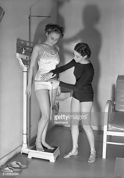 Before the resculpturing process starts the client is weighted and measured to determine strategic points of attack in the body beautifying campaign...