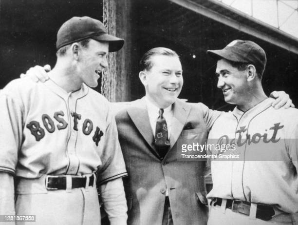 Before the start of a spring training game Boston Red Sox manager Joe Cronin and team owner Tom Yawkey share a laugh with Detroit Tigers manager...