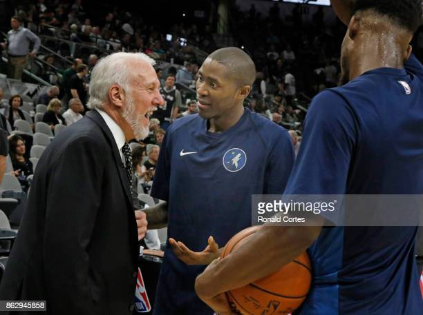 Before the start of the second half San Antonio Spurs head coach Gregg Popovich chats with Jamal Crawford of the Minnesota Timberwolves at ATT Center...