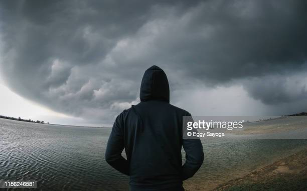 before the storm - hooded shirt stock pictures, royalty-free photos & images