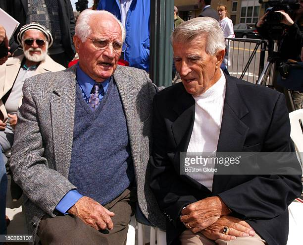 Before the unveiling of the Ted Williams Jimmy Fund Statue at Fenway Park Williams's former teammates Bobby Doerr left and Johnny Pesky chat with...