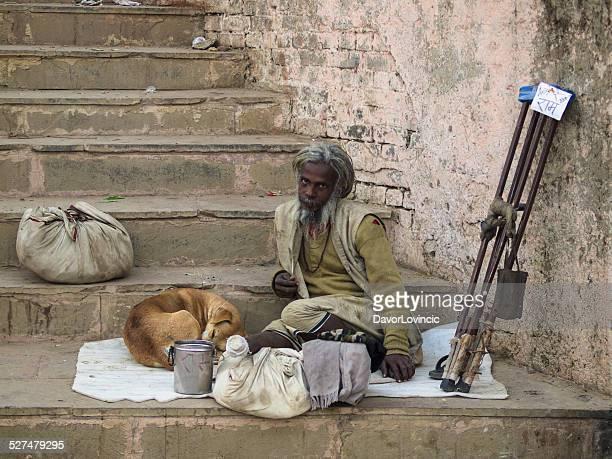 Beggar and a dog in Varanasi