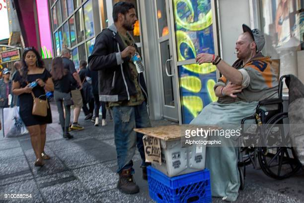 beggar on the streets of new york - homeless veterans stock photos and pictures