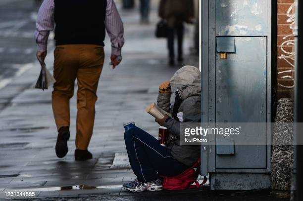 Beggar seen in Dublin city center during Level 5 Covid-19 lockdown. The Taoiseach Micheal Martin has just confirmed the extension of Ireland's Level...