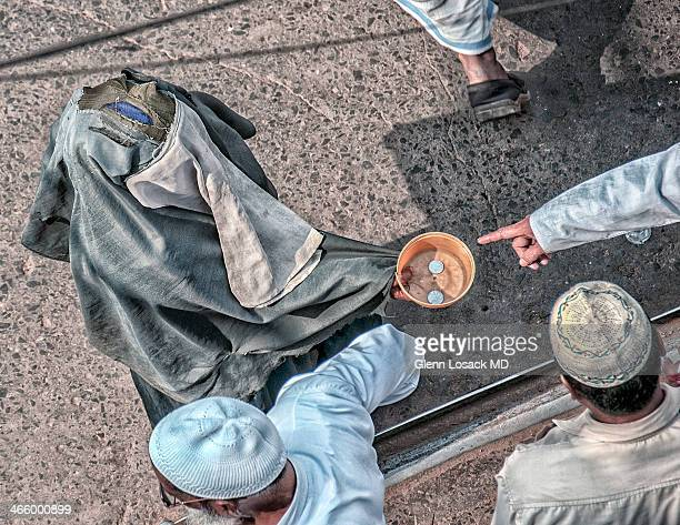 Beggars at friday Muslim prayer this one dressed in torn Burka Kolkata, INDIA