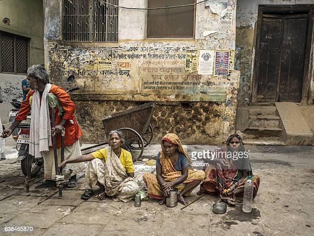 Beggars in a street in Varanasi India