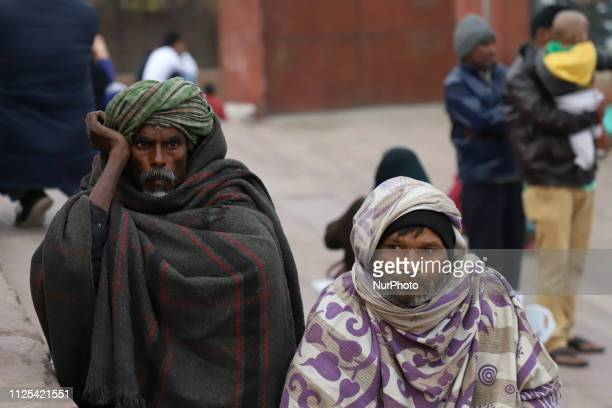 Beggars wait for Alms on the stairs of Jama Masjid in the Old Quarters of Delhi India on 16 February 2019
