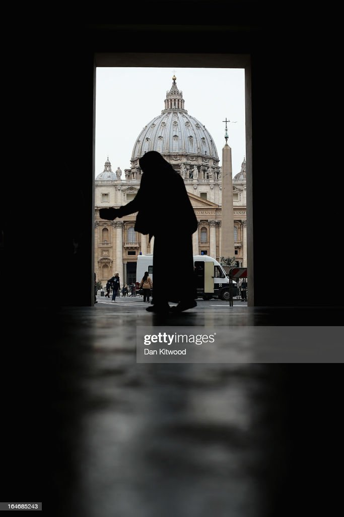 A begger asks people for money near St Peter's Basilica on March 26, 2013 in Rome, Italy. Recently elected Pope Francis declared that in his papalcy the catholic church would be a 'Church for the poor.'