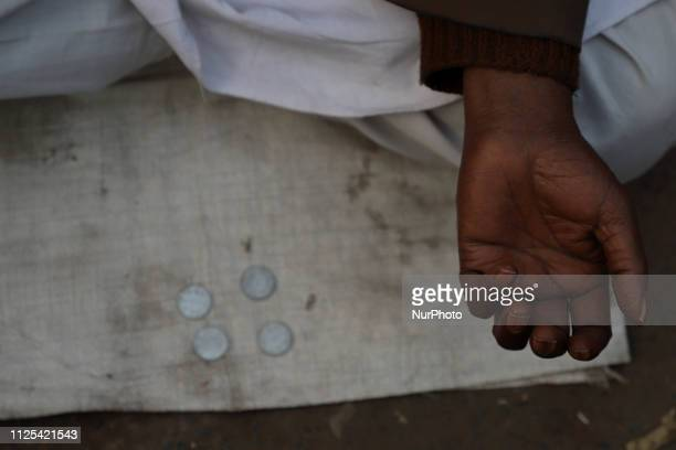 A Begger waits for monetary Help outside a Metro station in Old quarters of Delhi India on 16 February 2019