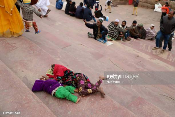 Beggers waiting for Alms on the stairs of Jama Masjid in the Old Quarters of Delhi India on 16 February 2019