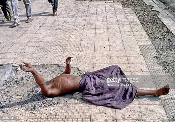 CONTENT] Begging in Kolkata India head in the sand on a brutally warm day Pedestrians pass right by