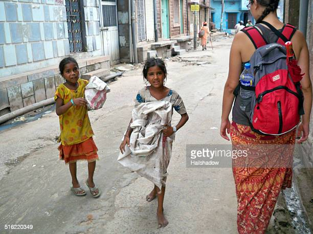 begging indian children - giving a girl head stock photos and pictures
