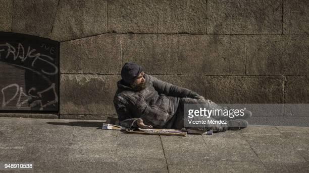 Begging lying on the sidewalk