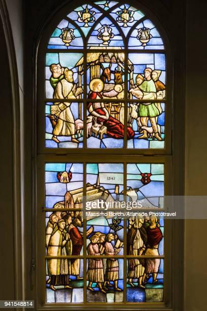 Begijnhof, Begijnhof Chapel (or Hidden Church), a stained-glass window by Gisele d'Ailly van Waterschoot van der Gracht