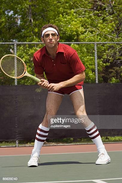 Beginner tennis player on tennis court