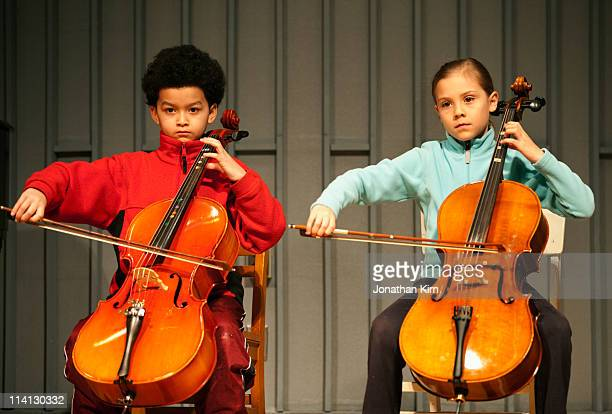Beginning cello students on stage.