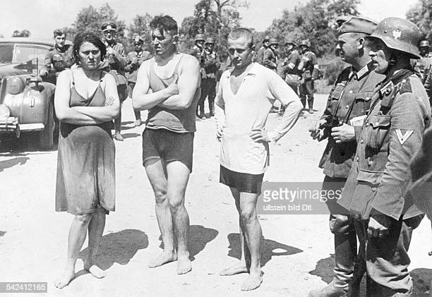 2WW Beginning of the campaign against soviet union /eastern front Prisoners of warTheee captured soviets among them a woman who shot hidden in water...