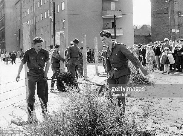 Beginning of the construction of the Berlin Wall concrete piles and barbed wire at the sector border in Prinzenstrasse