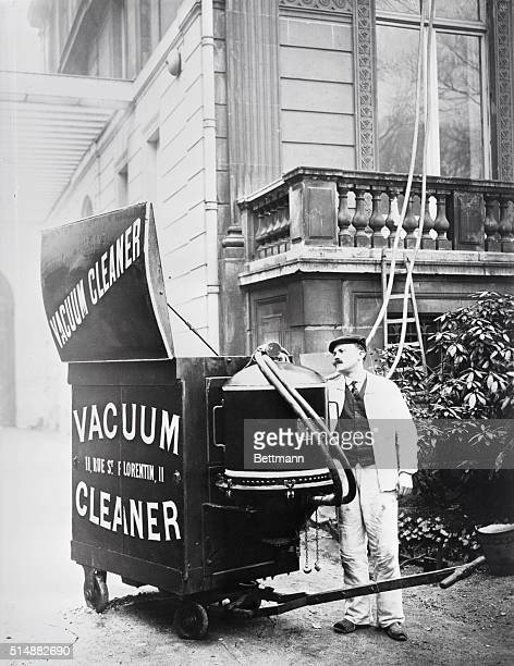 Beginning of the vacuum cleaner Movable gadget as wheeled up to house for a cleaning job ca 1900 photograph BPA