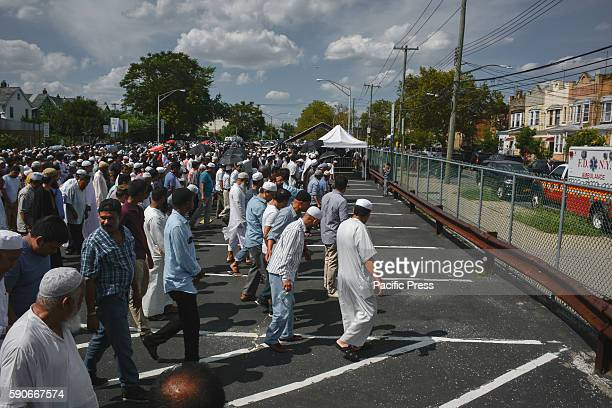 Beginning prayer Thousands gather to mourn slain Imam and his assistant after they were shot and killed from behind as they walked down the sidewalk...