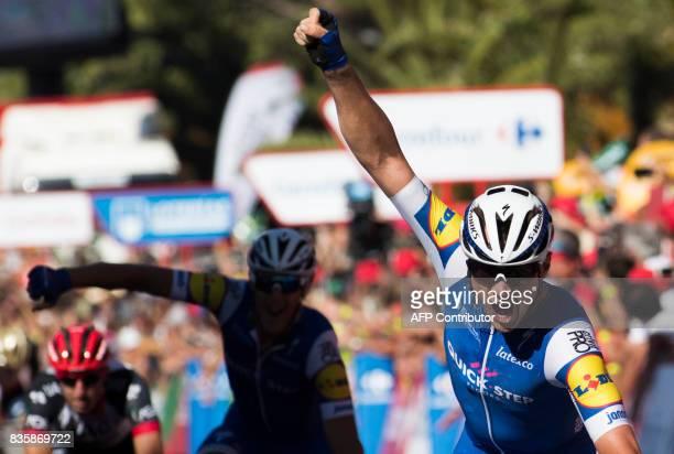 Begium's cyclist Yves Lampaert of QuickStep Floors celebrates as he crosses the finish line to win the 2nd stage of the 72nd edition of La Vuelta...