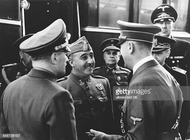 Begrüssung auf dem französischenGrenzbahnhof im Hintergrund derspanische Botschafter in BerlinEugenio Espinosa de los Monteros derspanische...