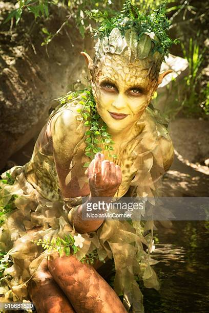 beguiling water nymph gestures invitingly - body paint stock pictures, royalty-free photos & images