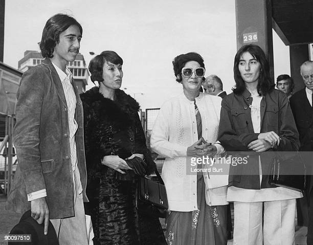 Begum Almas Daulatana wife of the Pakistani Ambassador greets the wife and children of Pakistani President Zulfikar Ali Bhutto at London Airport 14th...