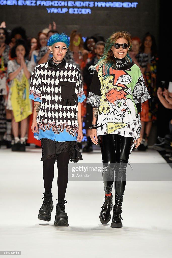 Begum Berdan (L) and Deniz Berdan (R) walk the runway at the DB Berdan show during Mercedes-Benz Fashion Week Istanbul at Zorlu Center on October 13, 2016 in Istanbul, Turkey.