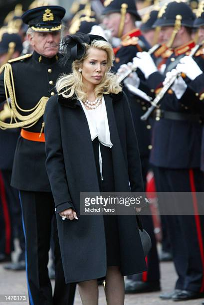 Begum Inyaari wife to The Aga Khan bows to the Dutch Royal standard after the funeral of Prince Claus of the Netherlands at the Nieuwe Kerk church...