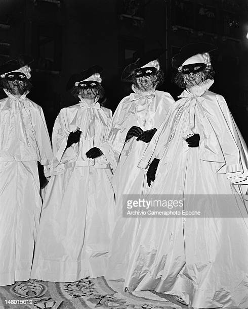 Begum Om Habibeh Aga Khan with fellow guests at a masked costume ball at the Palazzo Labia Venice 3rd September 1951 Named 'Le Bal Oriental' and...