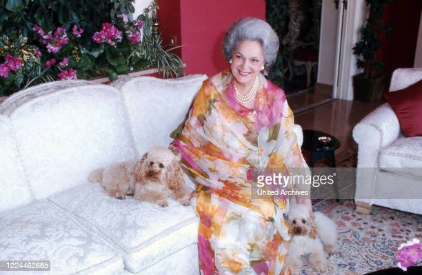 Begum Om Habibeh Aga Khan with her poodles at her house in Le Cannet, France 1985.