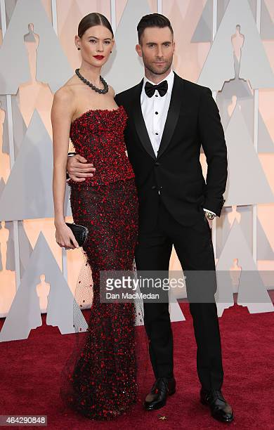 Behati Prinsloo and Adam Levine arrive at the 87th Annual Academy Awards at Hollywood Highland Center on February 22 2015 in Los Angeles California
