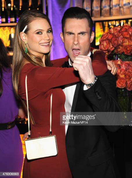 Behati Prinsloo and Adam Levine attend the 2014 Vanity Fair Oscar Party Hosted By Graydon Carter on March 2, 2014 in West Hollywood, California.