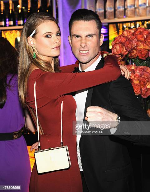 Behati Prinsloo and Adam Levine attend the 2014 Vanity Fair Oscar Party Hosted By Graydon Carter on March 2 2014 in West Hollywood California