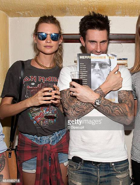 Behati Prinsloo and Adam Levine attend the launch party for Herring Herring Framed magazine at Lovers Of Today on September 3 2014 in New York City