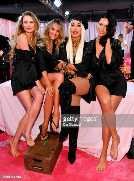 Behati Prinsloo Candice Swanepoel Rita Ora and Adriana Lima prepare backstage during 2018 Victoria's Secret Fashion Show in New York at Pier 94 on...