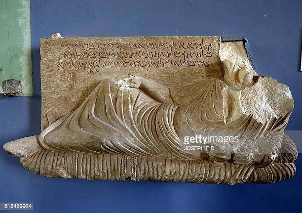A beheaded and mutilated statue is seen in the destroyed museum in the ancient Syrian city of Palmyra on March 31 2016 Syrian troops backed by...