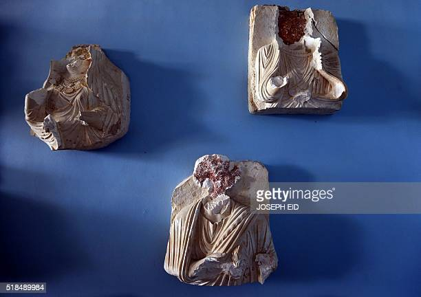 Beheaded and mutilated statues are seen in the destroyed museum in the ancient Syrian city of Palmyra on March 31 2016 Syrian troops backed by...
