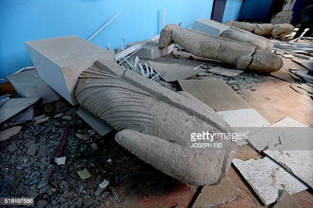 Beheaded statues are seen on the ground in the destroyed museum in the Syrian ancient city of Palmyra on March 31, 2016. Syrian troops backed by...