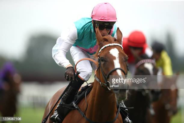 Beheld ridden by jockey Jason Watson wins the Unibet Thanks The Frontline Workers EBF Fillies' Novice Stakes race at Newbury Racecourse on August 16...