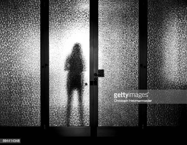Behind a glass door